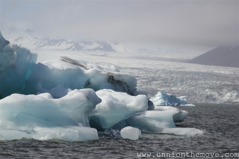 Icebergs floating in the Jokulsarlon lagoon with the glacier in the background
