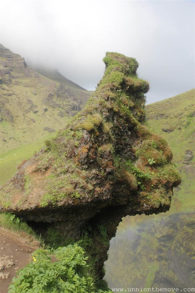 A weird face shaped rock at the top of the Skogafoss waterfall