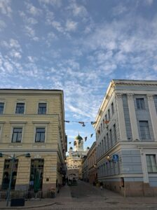 Finland street with white church in background